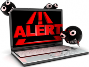 Laptop Computer with Virus Alert on screen